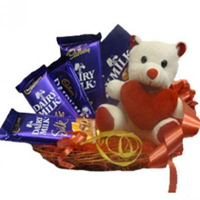 Teddy in Basket With Chocolates