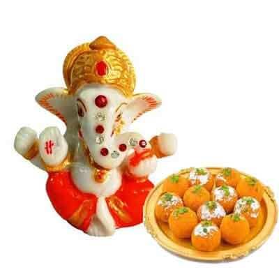 Lord Ganesh Idol with Laddu